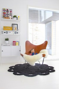 Child In Butterfly Chair of Vegetable Tanned Leather And Icelandic Sheepskin