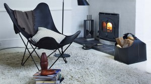 A black butterfly chair in a warm cosy room.