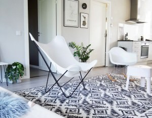 White leather butterfly chair and vitra rocking chair